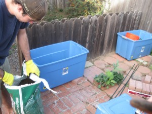 Raised beds from plastic storage containers agridude - Soil for container vegetable gardening ...